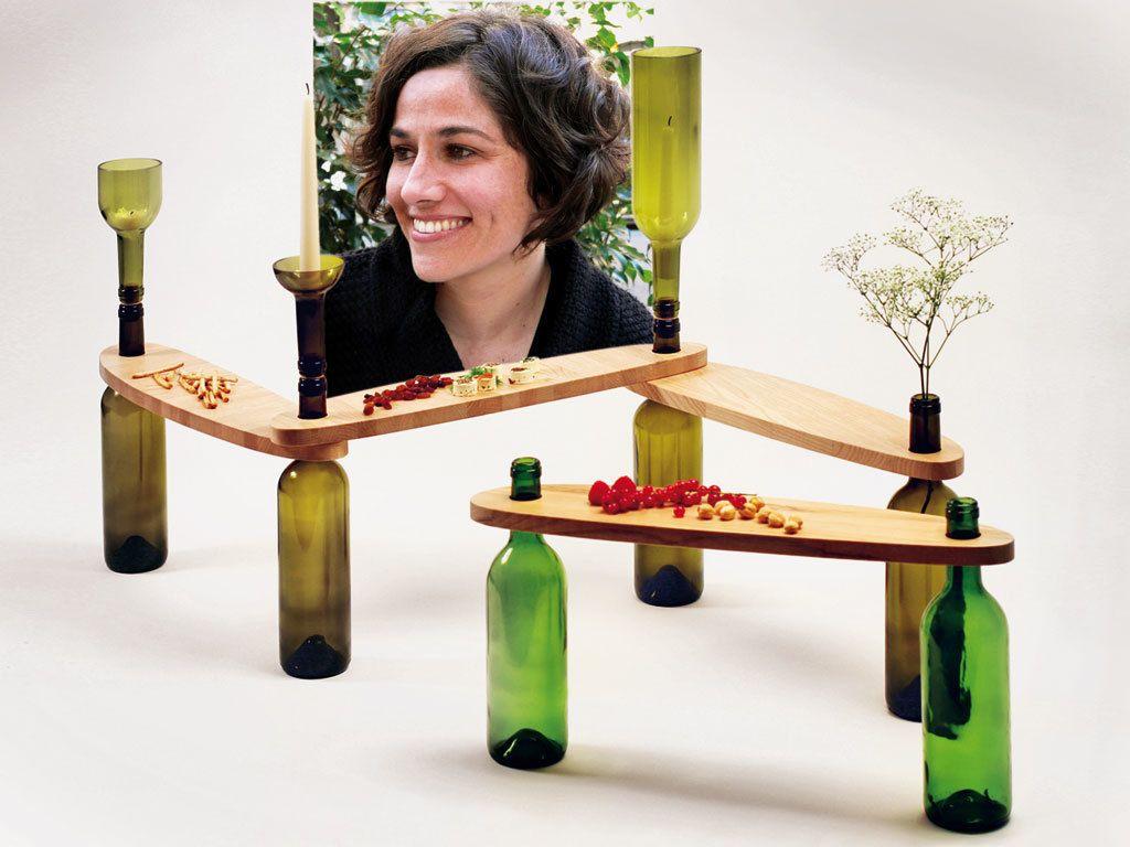 <p>La brasileña afincada en Barcelona llevó al Salón Satélite sus proyectos eco, como las mesitas Dvinus, con tableros que se apoyan en botellas de vino recicladas que, además de ejercer de patas, actúan de candelabros, jarrones...</p>