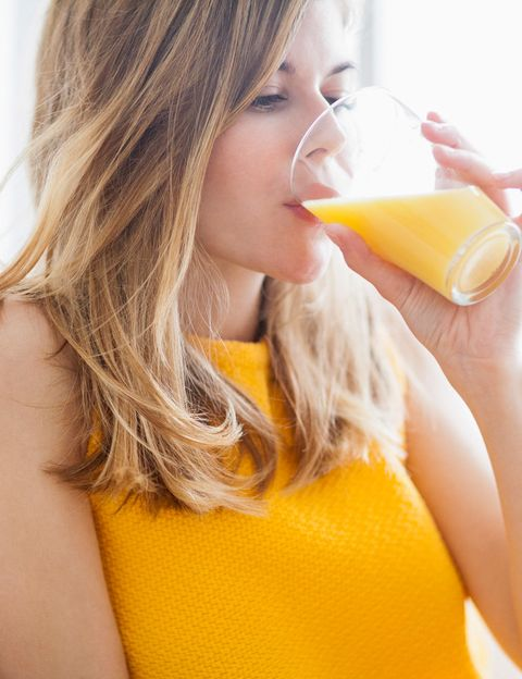 Orange juice, Hair, Orange drink, Juice, Blond, Orange soft drink, Yellow, Skin, Beauty, Drinking,