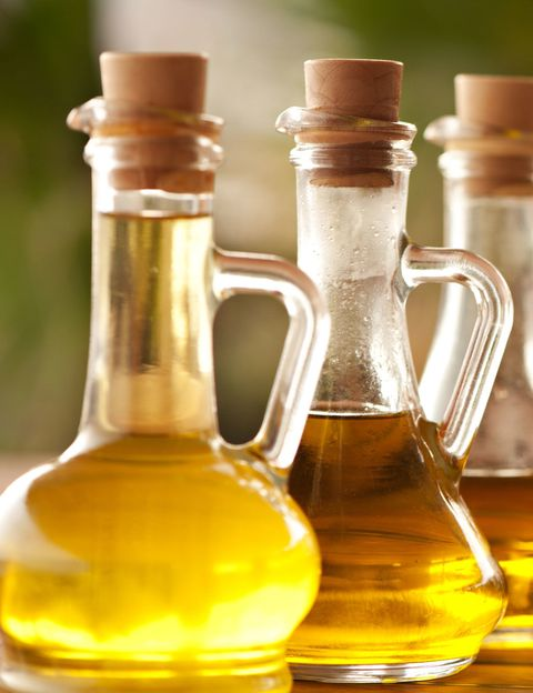 Vegetable oil, Glass bottle, Yellow, Bottle, Soybean oil, Cooking oil, Glass, Cottonseed oil, Drink, Honey,