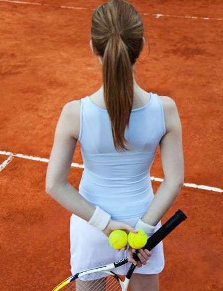 Hairstyle, Shoulder, Elbow, Sports equipment, Joint, Style, Orange, Tennis racket, Back, Tennis ball,