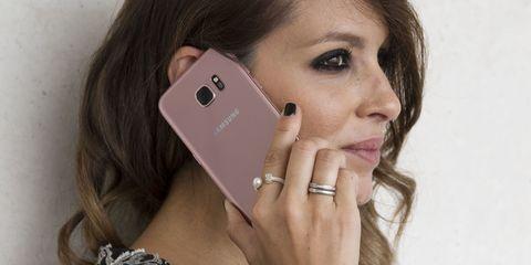 Mobile phone, Portable communications device, Eyelash, Beauty, Wrist, Communication Device, Gadget, Smartphone, Neck, Long hair,