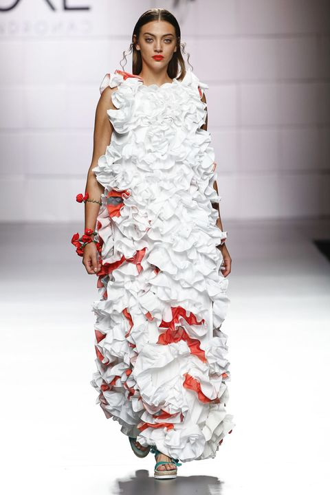 Clothing, Shoulder, Dress, Fashion show, Joint, Red, Style, Fashion model, One-piece garment, Fashion,