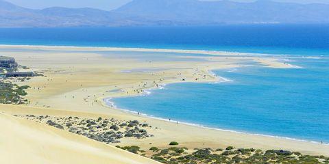 Body of water, Sand, Coast, Beach, Sky, Sea, Natural environment, Shore, Coastal and oceanic landforms, Dune,