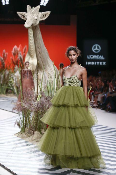 Fashion show, Dress, Style, Formal wear, Fashion model, Runway, Waist, Gown, Sculpture, Fashion,