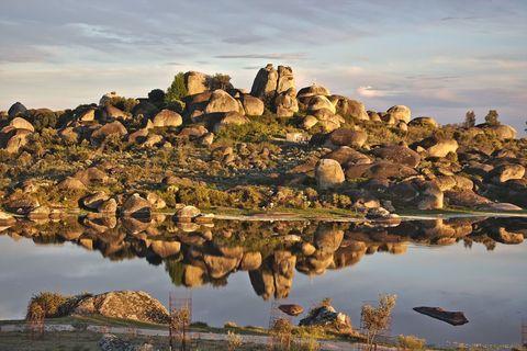 Natural landscape, Rock, Landscape, Bedrock, Reflection, Bank, Lake, Geology, Formation, Outcrop,