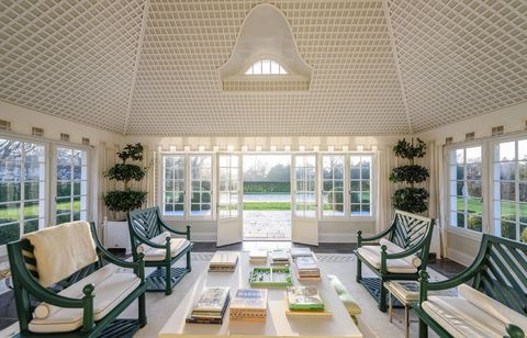 Interior design, Room, Green, Floor, Property, Furniture, Table, Flooring, Ceiling, Couch,