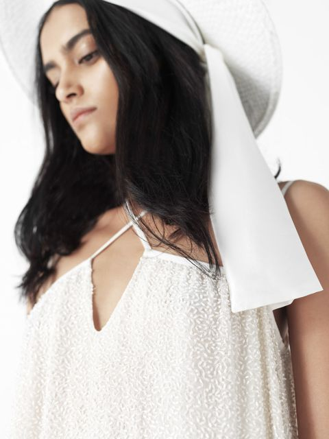 Clothing, Skin, Shoulder, Textile, Joint, White, Costume accessory, Veil, Fashion, Beauty,