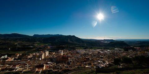 Sun, Landscape, Residential area, Hill, Astronomical object, Lens flare, Sunlight, Suburb, Terrain, Aerial photography,