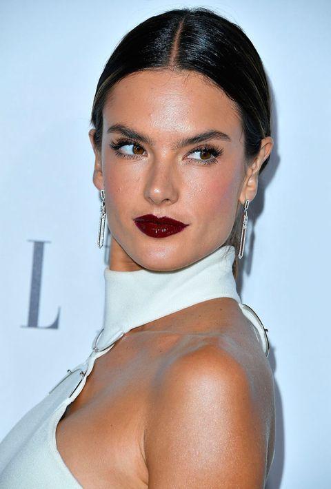 Lip, Hairstyle, Shoulder, Earrings, Eyebrow, Eyelash, Jewellery, Style, Eye shadow, Neck,