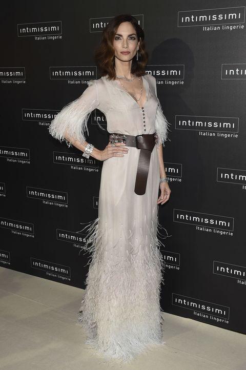 Clothing, Human, Dress, Shoulder, Style, Fashion model, Waist, Flooring, Fashion, Gown,