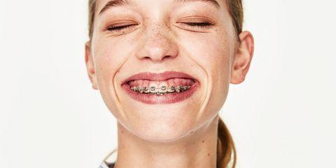 Ear, Lip, Cheek, Dress shirt, Collar, Skin, Chin, Forehead, Eyebrow, Tooth,