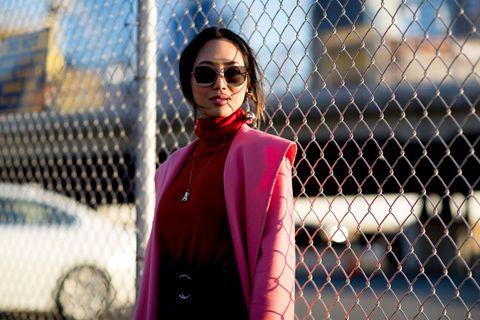 Eyewear, Glasses, Vision care, Lip, Sunglasses, Coat, Collar, Outerwear, Fashion accessory, Style,