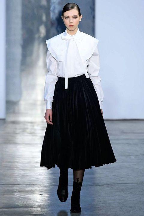 Fashion model, Fashion, Fashion show, Runway, Clothing, White, Haute couture, Neck, Shoulder, Fashion design,