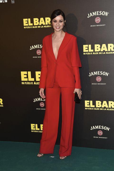 Sleeve, Red, Style, Formal wear, Blazer, Logo, Carpet, Fashion, Fashion model, Pantsuit,