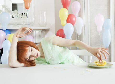 White, Beauty, Skin, Yellow, Room, Leg, Sitting, Furniture, Bed sheet, Textile,
