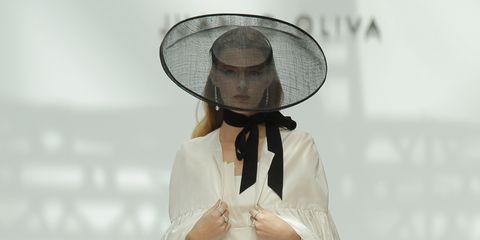 Skin, Hat, Dress, One-piece garment, Headgear, Costume accessory, Fashion, Fashion show, Day dress, Costume design,