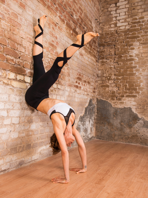 Shoulder, Leg, Wall, Joint, Beauty, Physical fitness, Dance, Athletic dance move, Arm, Human leg,
