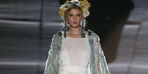 Shoulder, Fashion show, Dress, Style, Bridal clothing, Headpiece, Formal wear, Gown, Fashion model, Runway,
