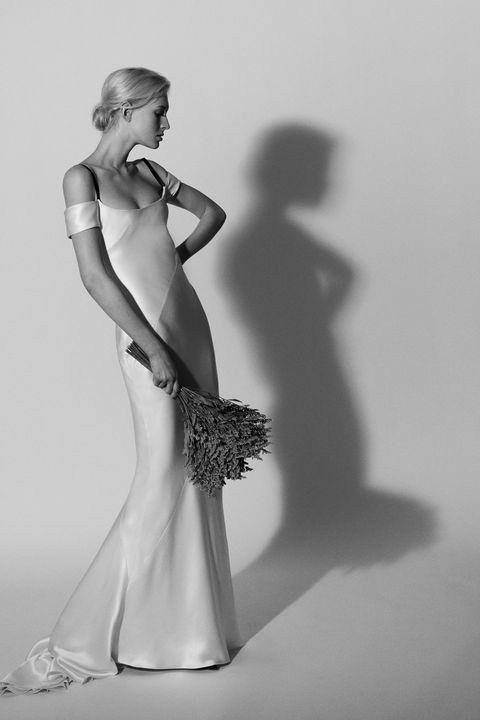 Shoulder, Joint, Standing, Elbow, Style, Waist, One-piece garment, Dress, Wrist, Monochrome,