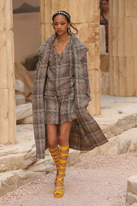 Fashion, Fashion model, Clothing, Runway, Fashion show, Street fashion, Yellow, Outerwear, Footwear, Fashion design,