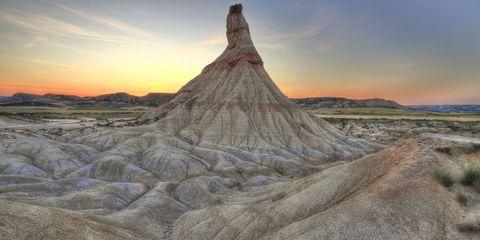 Badlands, Sky, Nature, Mountainous landforms, Rock, Cloud, Mountain, Formation, Geology, Landscape,