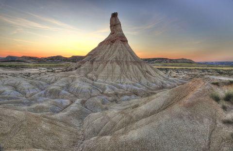 Landscape, Ecoregion, Sunset, Geology, Volcanic landform, Formation, Volcanic field, Badlands, Dusk, Geological phenomenon,