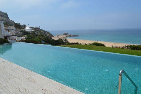Swimming pool, Sea, Coast, Property, Azure, Vacation, Coastal and oceanic landforms, Beach, Bay, Resort,