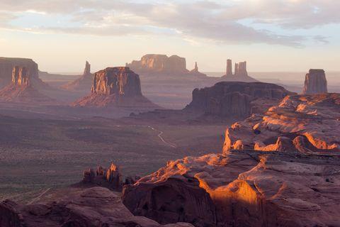Badlands, Butte, Mountainous landforms, Sky, Formation, Rock, Geological phenomenon, Ecoregion, Geology, Plateau,