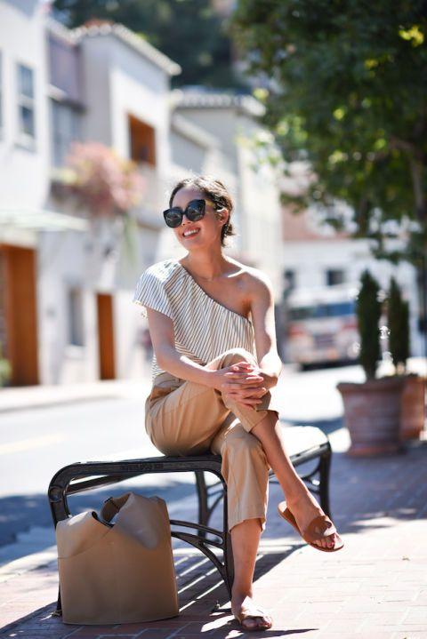 Sunglasses, Street fashion, Shoulder, Eyewear, Sitting, Summer, Leg, Footwear, Vacation, Shoe,