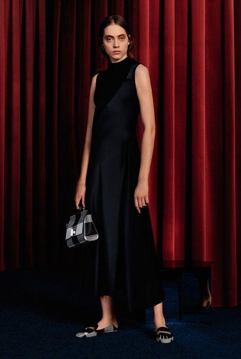 Dress, Clothing, Fashion, Little black dress, Shoulder, Footwear, Fashion model, Formal wear, Event, Neck,
