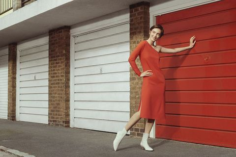 Red, Door, Wall, Standing, Footwear, Brick, Dress, Shoe, Window, Leg,