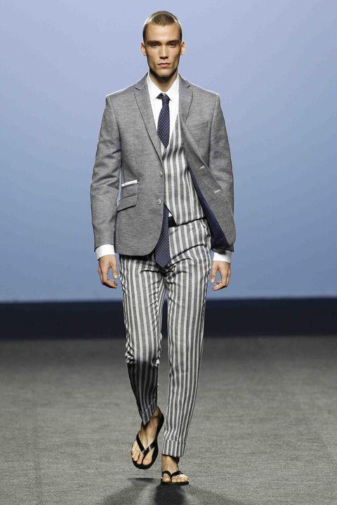 Suit, Clothing, Fashion, Blazer, Formal wear, Runway, Outerwear, Fashion model, Fashion show, Footwear,