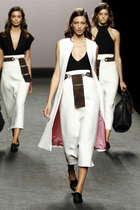 Fashion model, Fashion, White, Clothing, Runway, Fashion show, Shoulder, Dress, Waist, Fashion design,