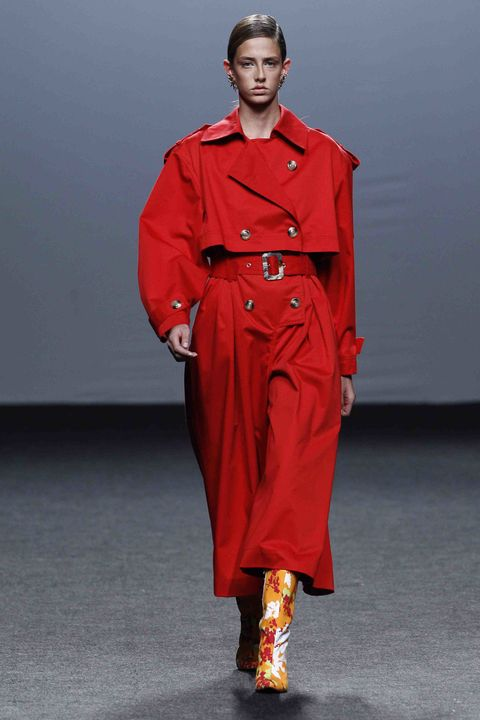 Fashion model, Clothing, Fashion, Runway, Red, Fashion show, Trench coat, Coat, Overcoat, Outerwear,