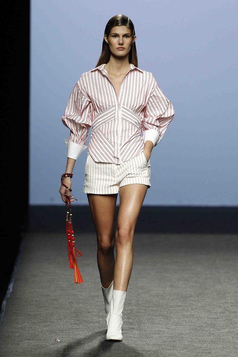 Fashion model, Fashion, Runway, Fashion show, Clothing, Fashion design, Shoulder, Public event, Footwear, Joint,