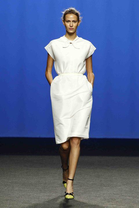 Fashion model, Fashion show, Clothing, Fashion, Runway, White, Blue, Shoulder, Fashion design, Dress,