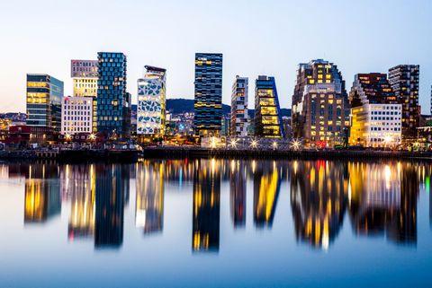 Cityscape, Metropolitan area, City, Reflection, Metropolis, Urban area, Skyline, Tower block, Human settlement, Sky,