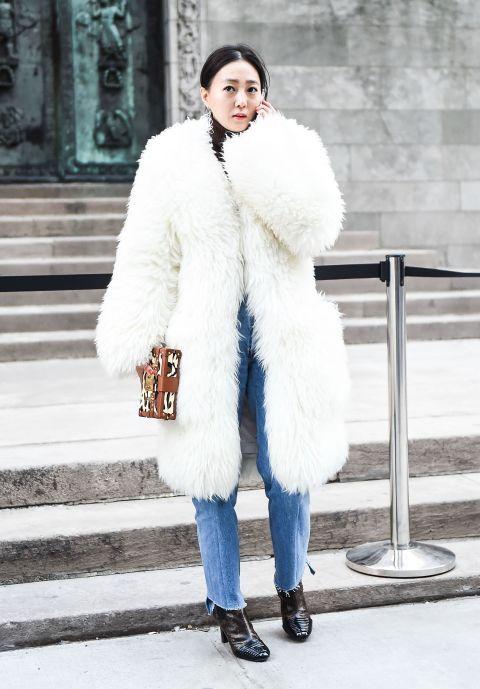 Fur, Clothing, White, Fur clothing, Street fashion, Fashion, Coat, Outerwear, Winter, Footwear,