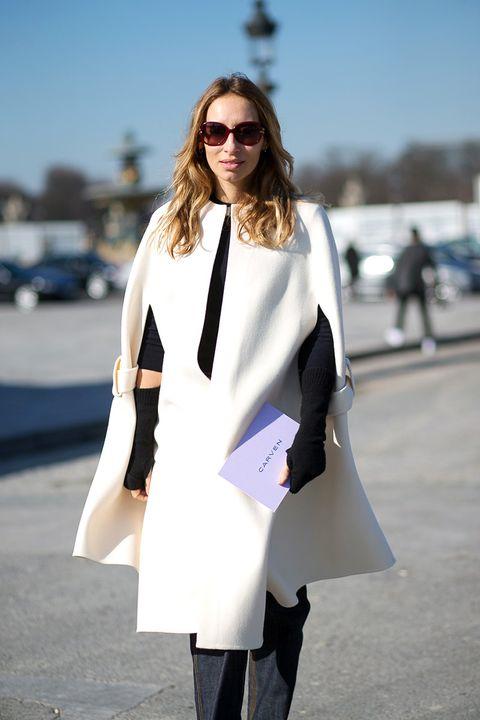 White, Clothing, Street fashion, Fashion, Outerwear, Coat, Eyewear, Black-and-white, Snapshot, Trench coat,