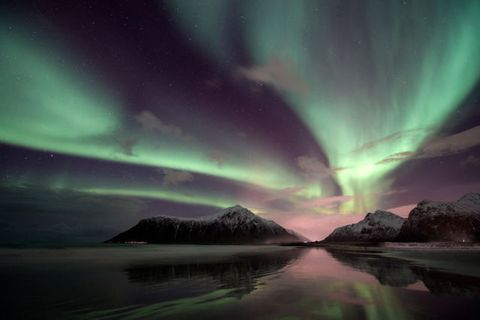 aurora borealis over the Lofoten Island of Flakstad?ya, Arctic Norway