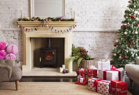 Living room, Christmas decoration, Room, Christmas stocking, Home, Fireplace, Christmas tree, Hearth, Interior design, Property,