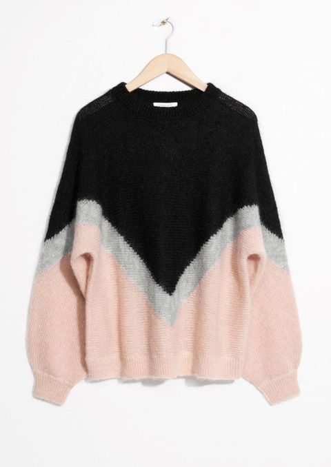 Clothing, Outerwear, Pink, Sleeve, Sweater, Fur, Clothes hanger, Beige, Wool, Costume,
