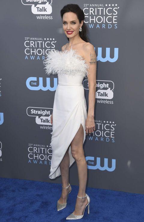 Dress, Clothing, Shoulder, Cocktail dress, Premiere, Joint, Fashion model, Carpet, Strapless dress, Leg,
