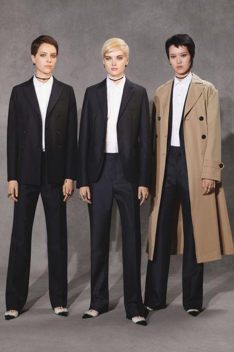 Suit, Formal wear, Clothing, Tuxedo, Outerwear, Standing, Blazer, White-collar worker, Pantsuit, Uniform,