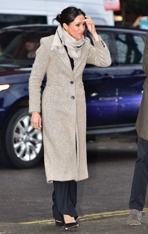 Clothing, Street fashion, Coat, Overcoat, Trench coat, Fashion, Outerwear, Suit, Footwear, Headgear,