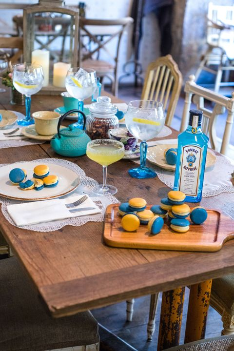 Table, Turquoise, Yellow, Furniture, Brunch, Room, Interior design, Liqueur, Drink, Coffee table,