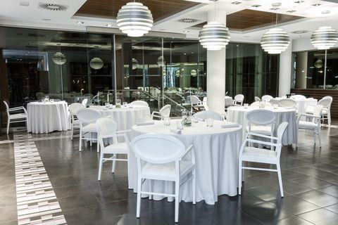 Restaurant, Table, Building, Column, Furniture, Chair, Room, Function hall, Interior design, Architecture,