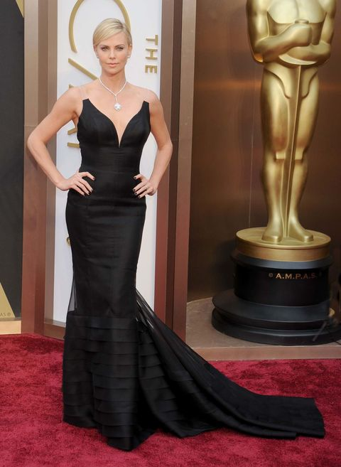 Dress, Red carpet, Carpet, Clothing, Gown, Fashion model, Shoulder, Flooring, Hairstyle, Haute couture,