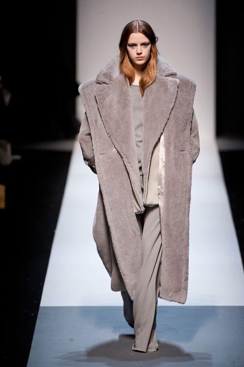 Sleeve, Fashion show, Outerwear, Fashion model, Coat, Style, Runway, Collar, Street fashion, Fashion,