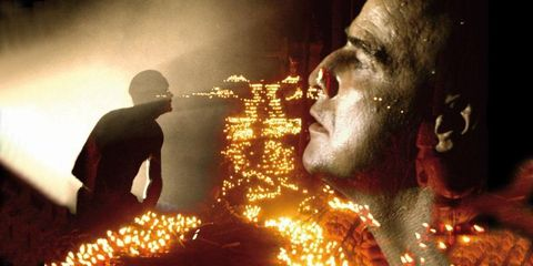 Temple, Facial hair, Heat, Fire, Tradition, Holiday, Flame, Ceremony,